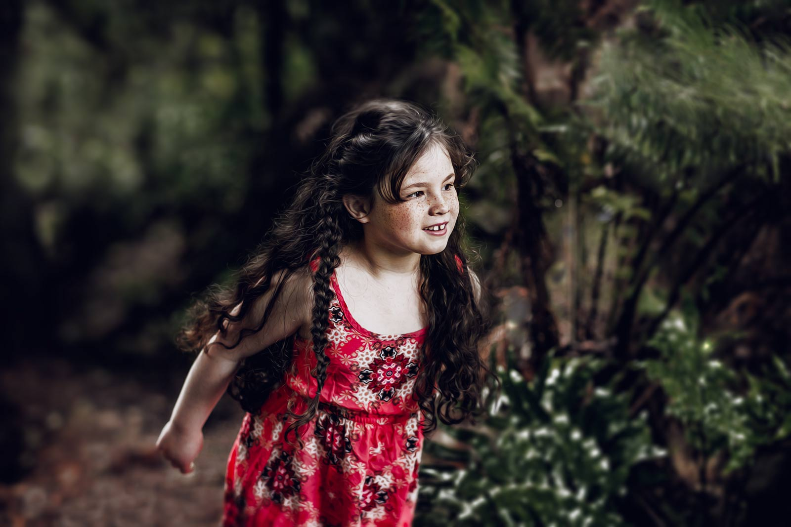 tween girl, long dark hair braided, red dress, in a forest looking curious